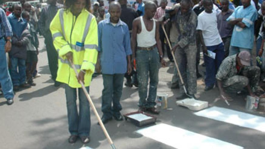 Painting a Zebra crossing during the Road Safty week. Clear road signs can reduce accidents.(File photo)