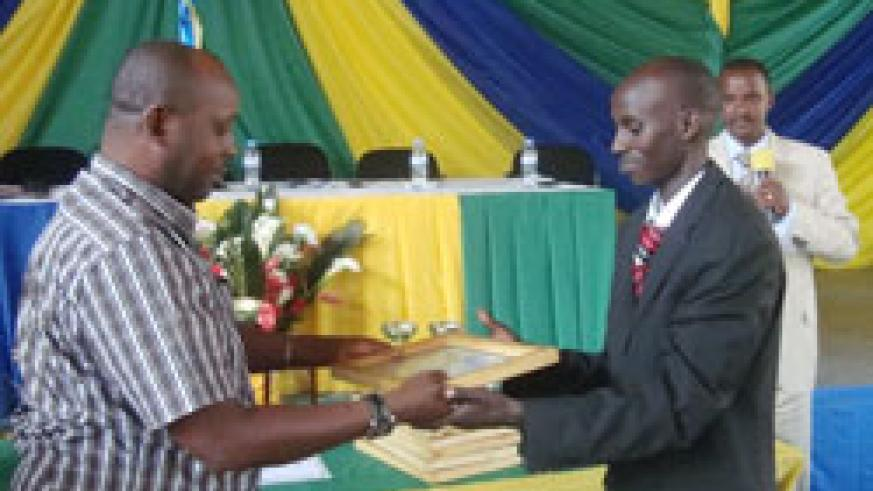 Rugabano Sector Executive Secretary Cyriaque Niyonsaba (R) was honoured for his tremendous achievements (Photo; S. Nkurunziza)