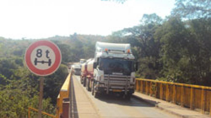 Trucks ferrying goods from Tanzania arrive at the Rusumo border post. (File photo)
