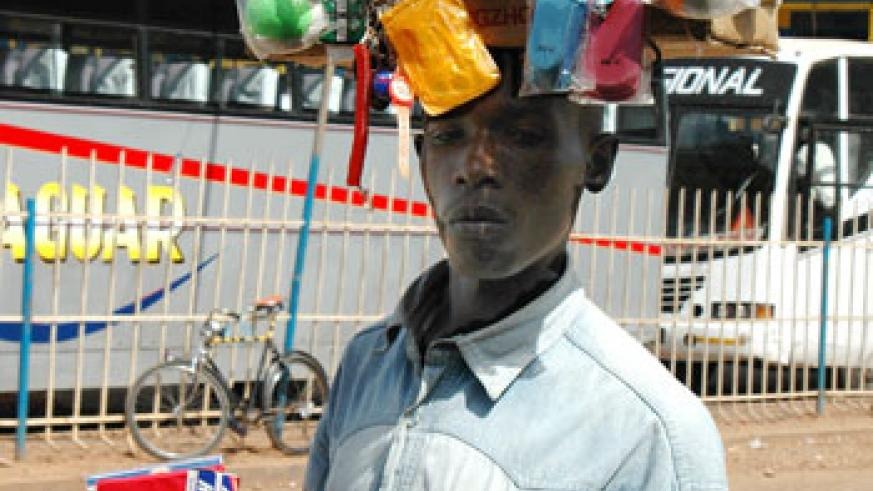 A hawker trades his wares in a Kigali street (File Photo)