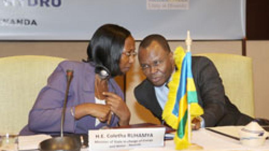 State minister Energy and Water (MININFRA) Hon. Coletha Ruhamya (L) consults with UN Resident Coordinator Aurélien Agbénonci (Photo; T. Kisambira)