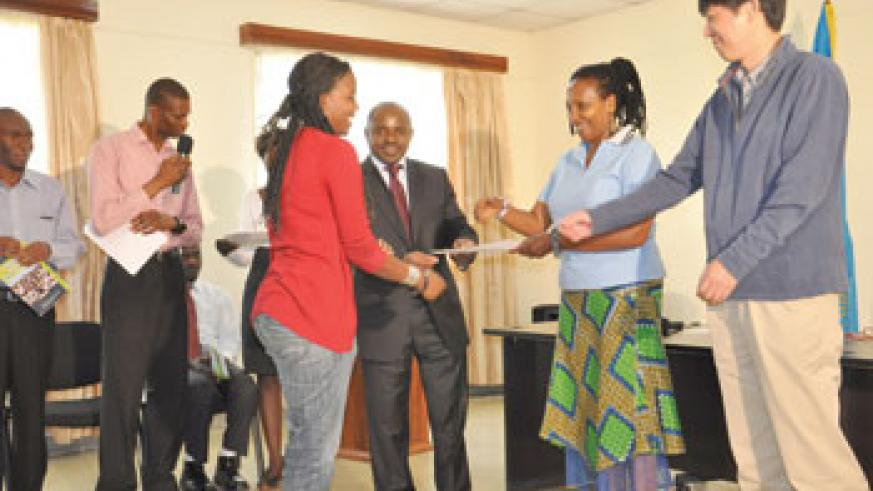 One of the students receiving a certificate after IT training (Photo by Fred Ndoli)