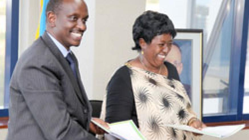 Former Health minister Dr. Richard Sezibera now EAC SG hands over to his successor Dr. Agnes Binagwaho yesterday (Photo T. Kisambira)