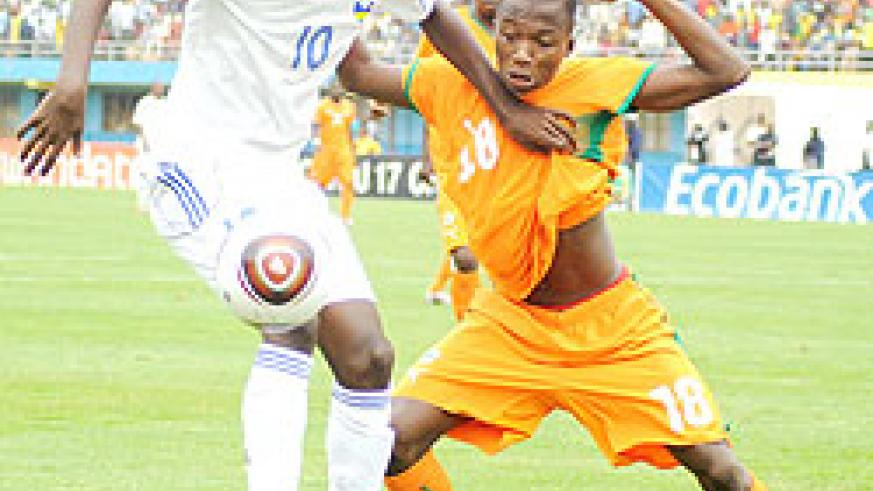 Andrew Buteera controls the ball against Ivory Coast in the Caf U-17 Championship early this year. The midfielder was one of the scorers yesterday. (File Photo)