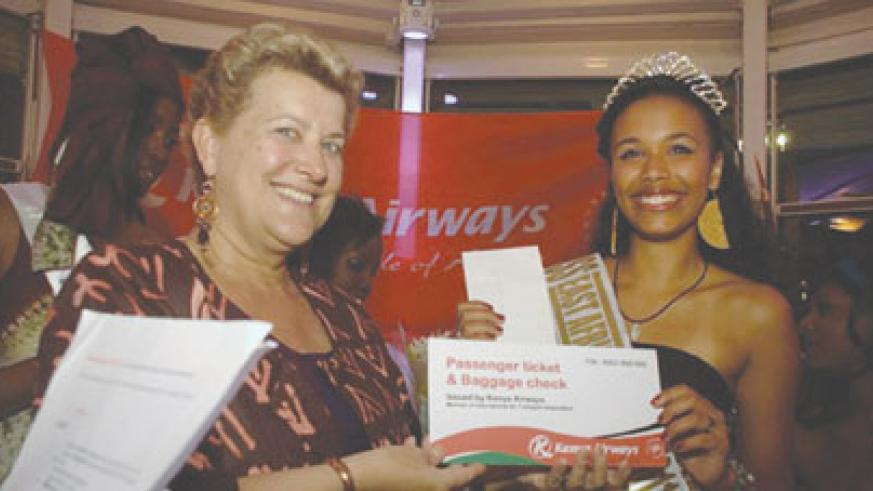 Kenya Airways France Country Manager Greta Swings (left) presents the winning prize of Miss East Africa Paris. (Net photo).