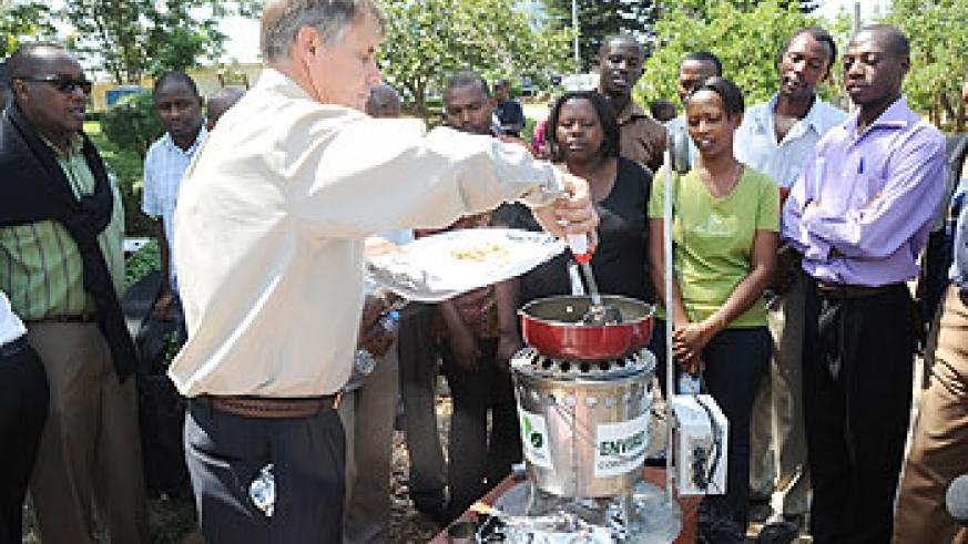 Rick Guthrie cooks to demonstrate how the enviro fuels stove works. (Photo J Mbanda)