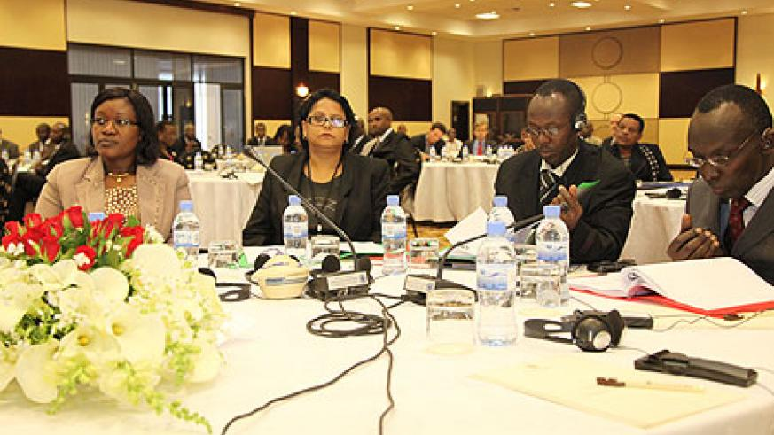 EAC Minister, Monique Mukaruliza (L) and Deputy Chief Justice Prof Sam Rugege at the IPR conference in Kigali (Photo T Kisambira)