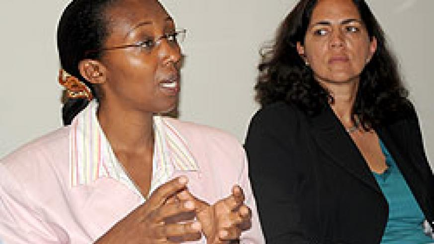 Minister Coletha Ruhamya and Yolande Coombes, a sanitation specialist, at the press conference. (Photo J Mbanda)