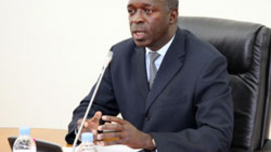 Minister of Labour, Anastase Murekezi during the news conference (Photo T.Kisambira)