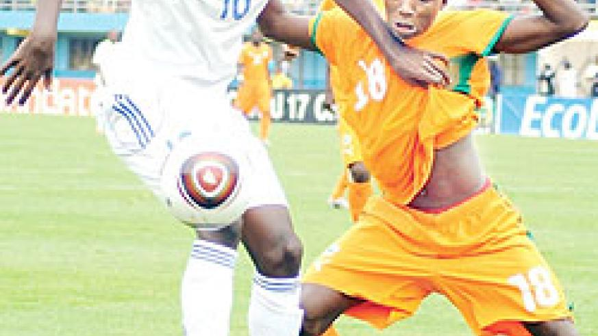 Andrew Buteera holds off an Ivory Coast player during the Caf U-17 Championship. He was one of the scorers on Thursday night. (File photo)