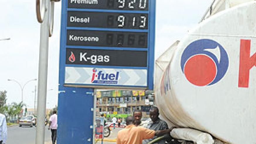 Fuel dealers expect pump prices to take a downward trend in 2011-12, owing to government's tax cut on fuel imports (File photo)