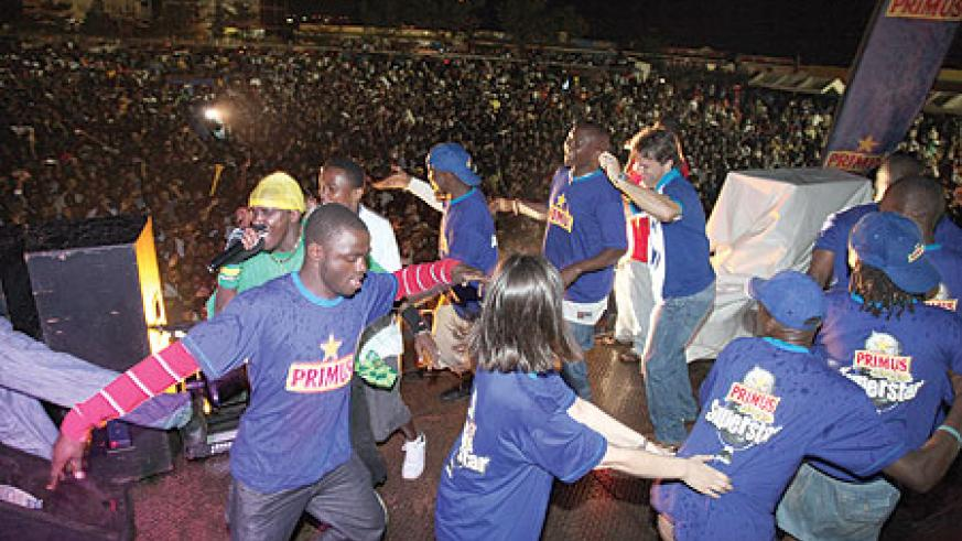 TAKING CENTRE STAGE: Primus Guma Guma team join singer Riderman (clad in a green T-shirt) on stage.