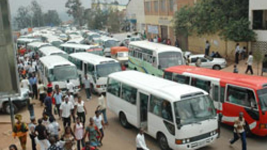 Commuter buses downtown Kigali. Transport fares have increased for the second time this year. (File photo)