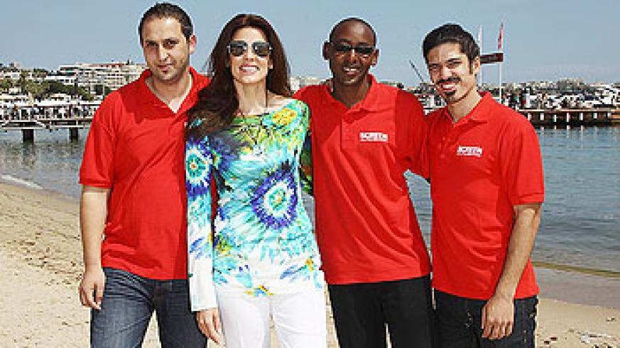 (L-R) Film Makers Ismail Al Qaisi,Pierre Kayitana and Omri Bezalel with Christina Astrade attend a Film Without Borders event during 64th Annual Cannes Film Festival at on May 18, 2011 in Cannes, France.