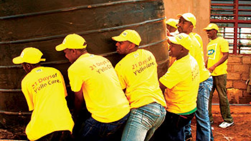 MTN staff assisting with installation of the  water tank at Sovu Secondary School. Photo S Rwembeho