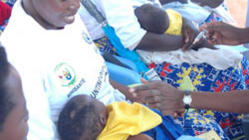 Mothers during a past immunisation exercise. Rwanda has welcomed the new immunisation funding boost from GAVI (File Photo)