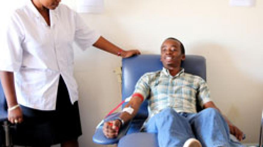 Nshimiyumuremyi Marie Vianney donates blood at CHUK. Several Rwandans donated blood during the just concluded blood donation week (File Photo )
