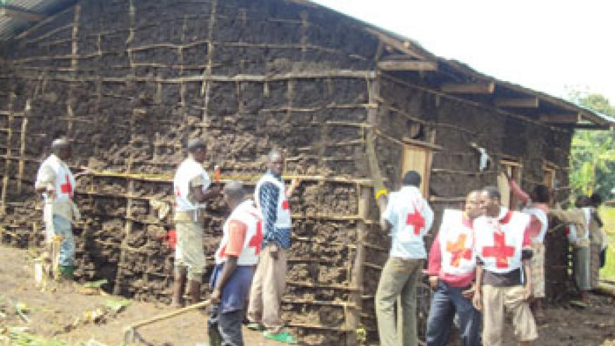 RRC volunteers  constructing a house in Remera cell Photo J P Bucyensenge