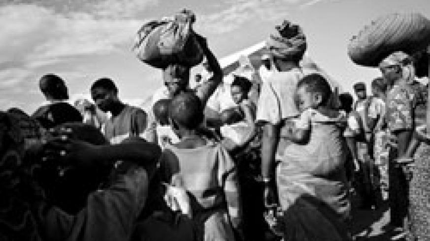 A group of refugees on the move. (Photo UNHR Gallery)