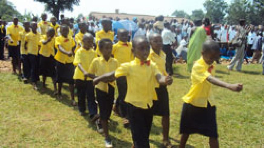 Children march during a national event to mark the Africa Child Day in Huye District yesterday. (Photo J P Bucyensenge)
