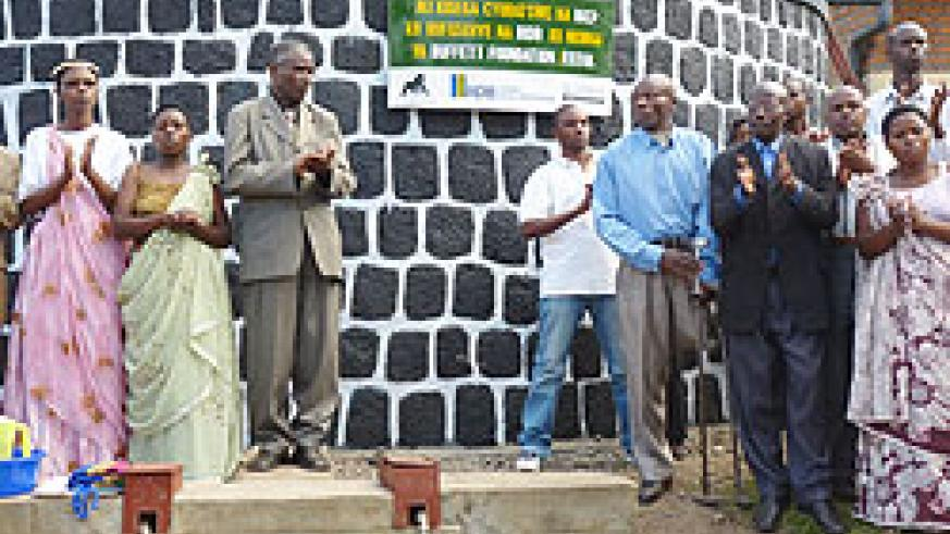 Residents at one of the public water collection tanks commissioned by RDB in Gahunga (Photo B Mukombozi)