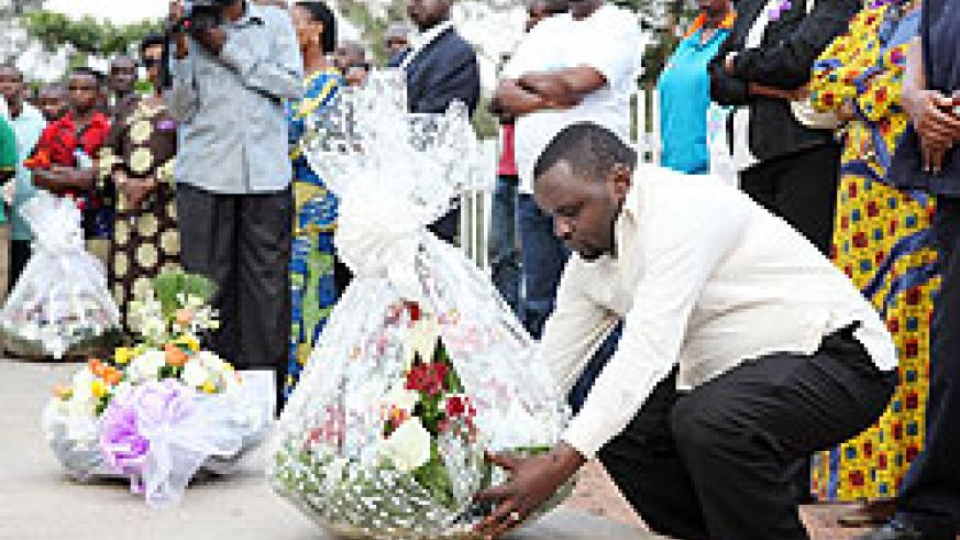Vice Mayor of Kigali City, Alphonse Ndayisenga lays a wreath in honour of its 14 former employees killed during the Genocide (Photo T.Kisambira)