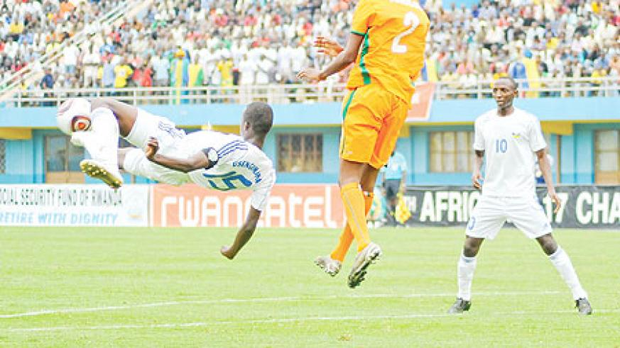 Usengimana clears the ball during the Caf U-17 Championship. The defender has been ruled out of Sunday's game. (File photo)