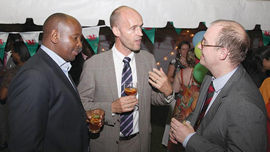 (L-R) Local Government Minister, James Musoni, High Counselor Mikael Lindvall of Sweden (C) and the UK High Commissioner, Benedict Llewellyn-Jones, during the Queen's Birthday celebrations over the weekend. (Photo/ T. Kisambira).