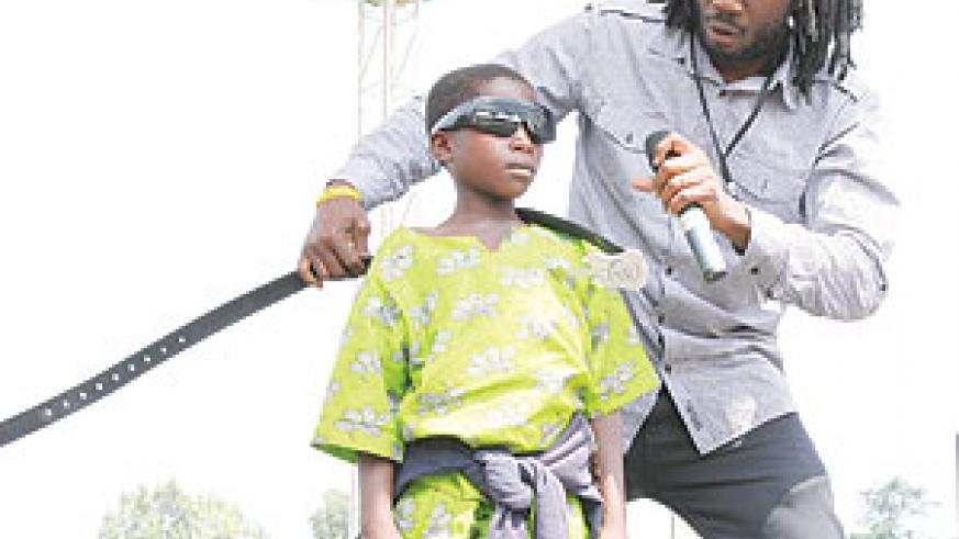 Lucky Boy! Ugandan artiste Bebe Cool was the star of the day after giving his Rwandan young fan his belt, shades and cash.