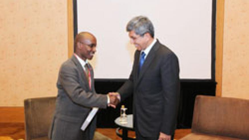 Ignace Gatare (L) with his Singaporean counterpart, Yaacob Ibrahim, after their discussions yesterday (Courtesy photo)