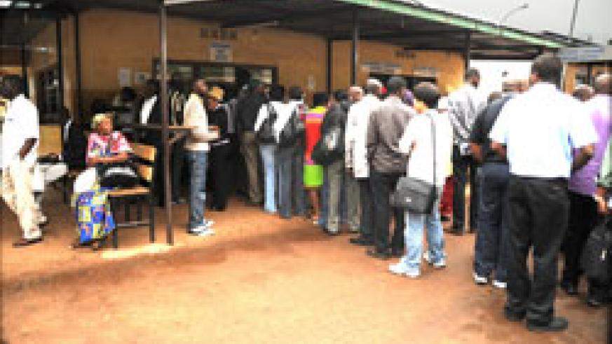 Passengers queue at Gatuna border post. The new immigration law will ease movement of East Africans (File Photo)