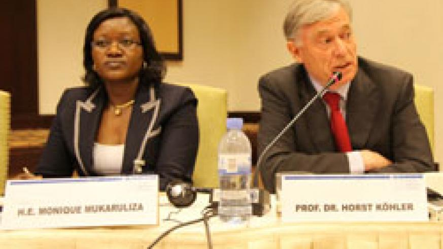 (L-R)EAC Minister Monique Mukaruliza together with the Former German President Horst Kohler in a meeting on Tuesday (Photo T.Kisambira)