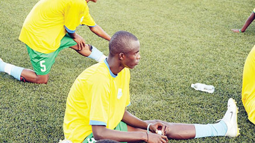 DOWN AND OUT; Defender Faustin Usengimana, seen here stretching in training, has been ruled out of action for four weeks with a knee injury. (File photo)