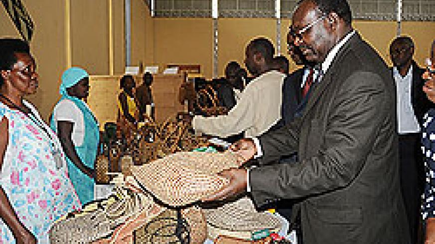 Minister of Trade and Industry Francois Kanimba admiring handcraft products at the  Handcraft Excellence Award Competition Expo which began Tuesday (File Photo)