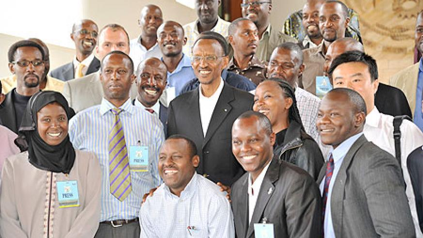 President Kagame poses with a group of journalists after the press conference yesterday (Photo Willis Shalita)