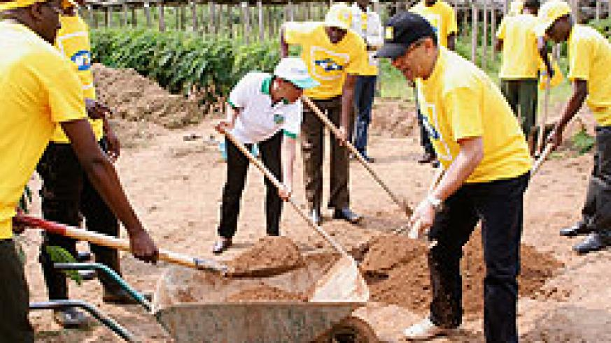 MTN's Khaled Mikkawi (in black cap) and DG of REMA, Dr Rose Mukankomeje participate in the preparation of a nursery bed in Rulindo District. (Courtesy photo)