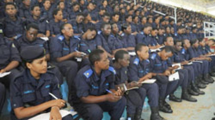Female Police officers keenly listen to a presentation during a workshop at Amahoro stadium yesterday. (Photo J Mbanda)