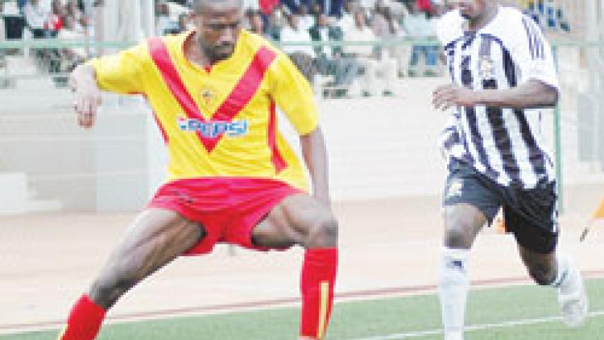A St. George defender protects the ball against APR's Mbuyu Twite during last year's friendly. APR lost 3-1 against the Ethiopians last evening. (File photo)