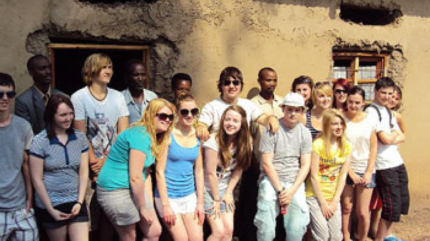 Scottish students pose for a photo with reconciled Genocide survivors and perpetrators.(Photo D.Sabiiti.J)