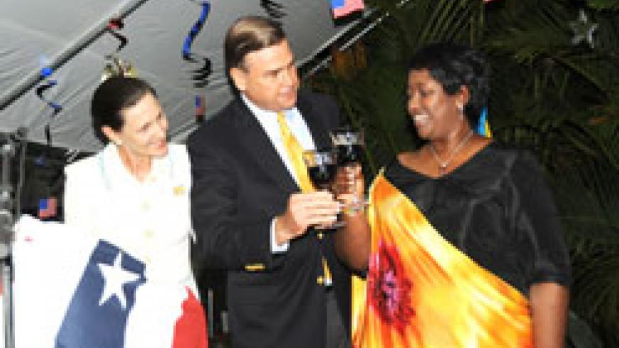 US Ambassador Stuart Symington (C), and Mrs Symington (L) with Health Minister, Dr. Agnes Binagwaho, at the US Independence  Day celebrations  (Photo /J Mbanda)