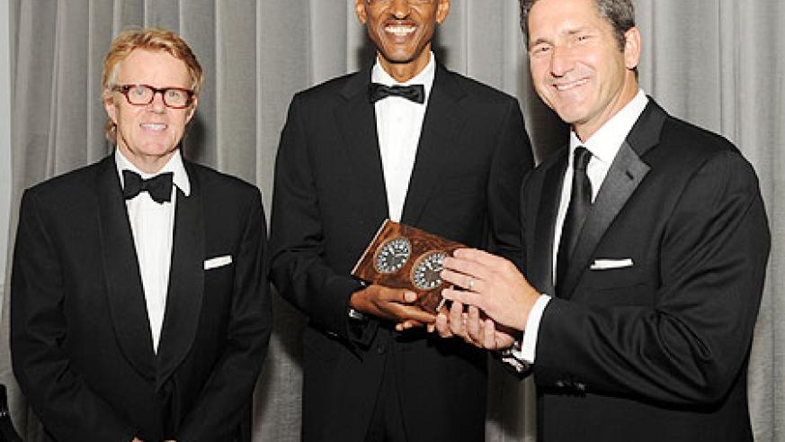 President Kagame receives award from Chello Foundation with chairman of Chello Foundation Shane O'Neill and CEO of Liberty Global Mike Fries