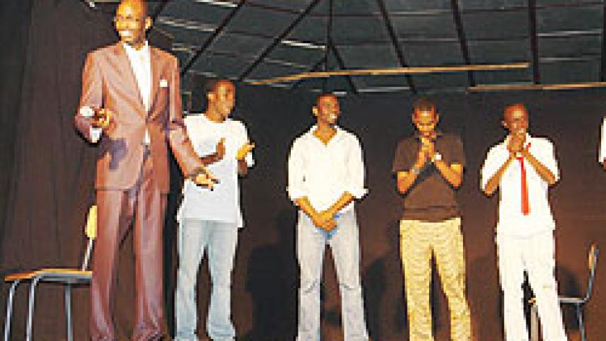 Herve Kaimenyi introduces his colleagues on stage. (Photo by J. Njata)