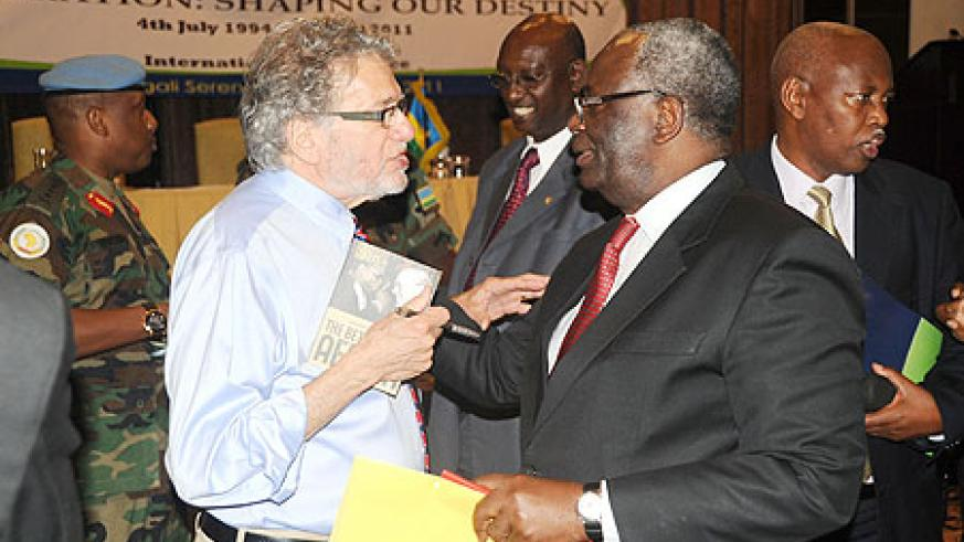 Dr. Gerry Caplan (L) chats with Ibrahim Gambari from UNAMID at the conference on Liberation as Gen. Patrick Nyamvumba (left) looks on. (Photo J Mbanda)