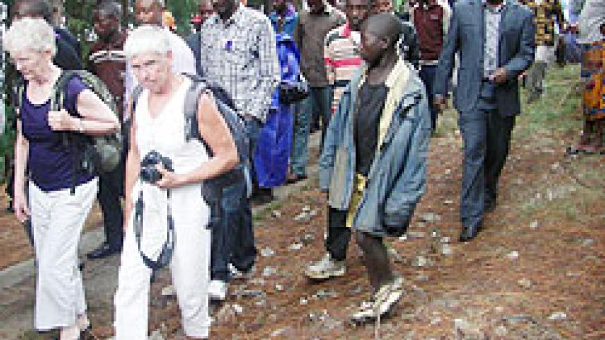 The visiting French nationals join other mouners in a walk to remember at Bisesero (photo S Nkurunziza)