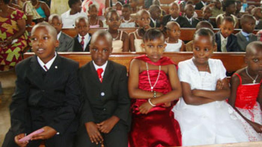 Gravis, Felix Mukono, Phiona Mukono and Benita Ibabaza at Regina Pacis church in Kimironko were cristened with other children.