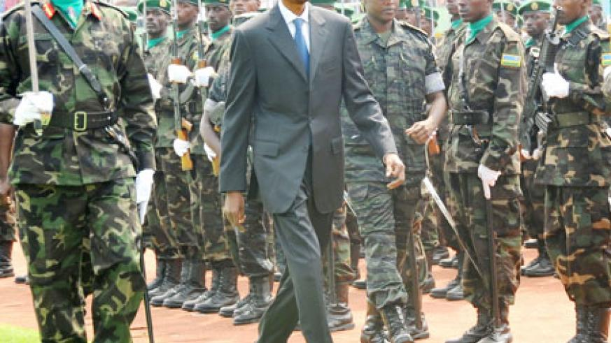 President Kagame inspects a guard of honour at the national celebrations to mark Liberation Day at Amahoro stadium, yesterday. (Photo J. Mbanda)