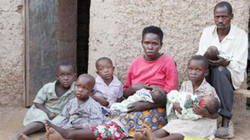 Theogene Murindabyuma(R) with wife and  their six children alongside his niece. There eldest daughter carries one of the Triplets (Photo T.Kisambira)