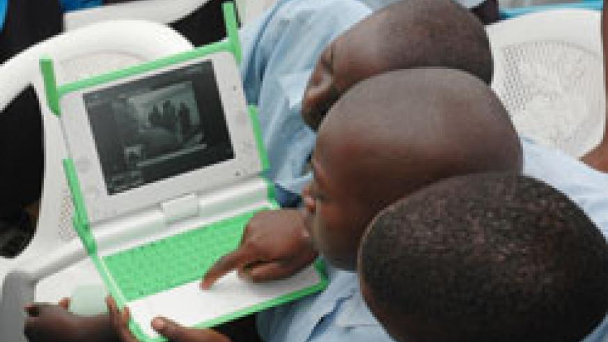 Primary school pupils using a laptop; MINEDUC has installed security systems in the laptops.(File Photo )