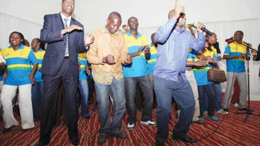 (L-R) Minister of Youth, Sport and Culture, Protais Mitali and Joseph Habineza reveal their rare dance moves. (Net photo)
