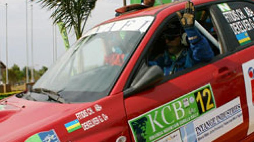 Fitidis waves to the crowd shortly after being flagged off during the 2009 KCB Rwanda Mountain Gorilla Rally. (File Photo)